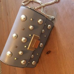 Pearl studded crossbody bag by Topshop.